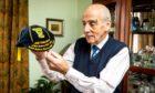 Referee Bob Valentine at home with his memorabilia.