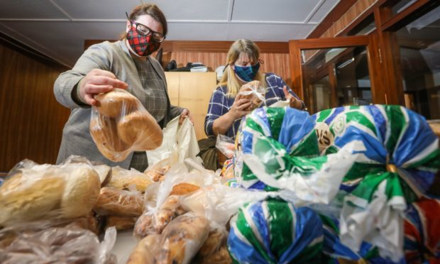 Angela Gordon and Bonnita Leighton make up food parcels. Friday 4th December, 2020. Mhairi Edwards/DCT Media