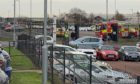 The Dryburgh Industrial Estate has been blocked off to traffic causing a build-up of vehicles.