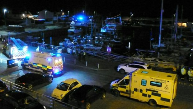 The car was lifted from the harbour on Christmas Eve, with emergency services attending.