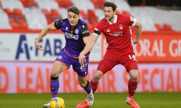 Dundee United forward Louis Appere takes on Aberdeen's Ash Taylor earlier in the season.