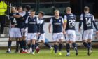 Dundee players celebrate the opening goal against Hearts.