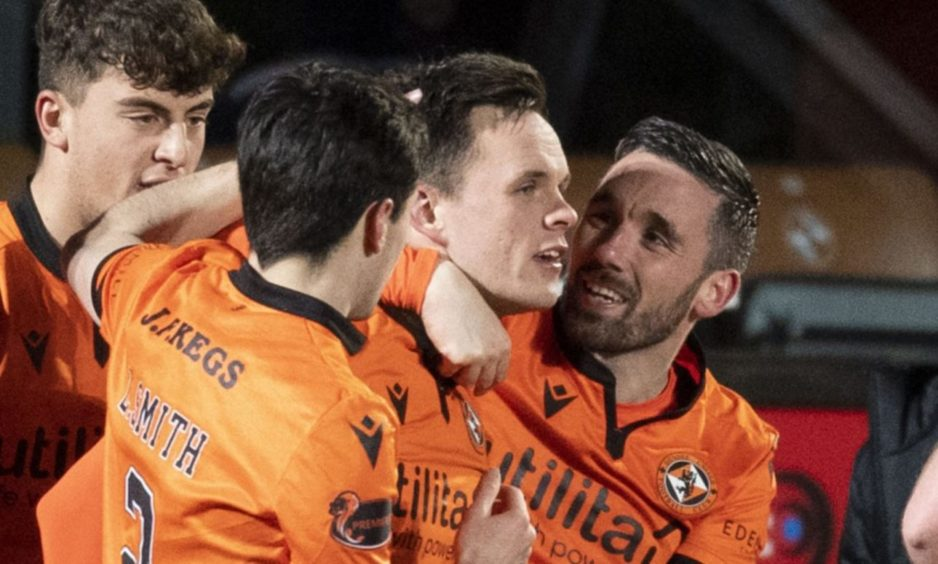 DUNDEE, SCOTLAND - JANUARY 12: Dundee United's Lawrence Shankland (centre) celebrates making it 2-2 during the Scottish Premiership match between Dundee United and St Johnstone at Tannadice Park on January 12, 2021, in Dundee, Scotland. (Photo by Ross Parker / SNS Group)