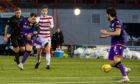 Lawrence Shankland fires just past the post.