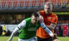 Dundee United defender Mark Connolly challenges Hibs winger Martin Boyle.