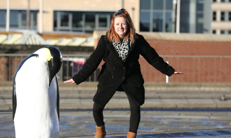 Amy Hall tries walking like a penguin to stop herself slipping.