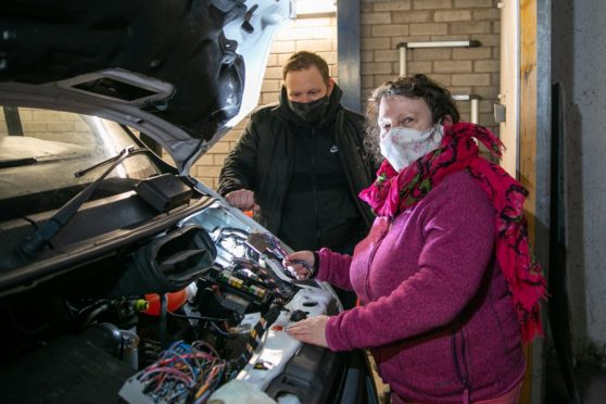 Lochee Community Group need a van as theirs has packed in, putting a stop to their services. Picture shows; l to r - Councillor Alan Ross and Alison Walker - founder of Lochee Community Group