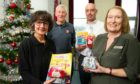 Major Carole Tucker, Major Gordon Tucker, with Chris McAuley and Pamela Grant from Salvation Army Employment Plus, Salvation Army Community Church, Thurso Crescent at the launch of their Christmas Toy Appeal in 2019.