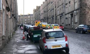 To go with story by James Simpson. 34-year-old man arrested in connection with a disturbance. Picture shows; Police vans and cars.. Rosefield Street, Dundee.. James Simpson/DCT Media Date; 16/01/2021