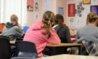 Dozens of school children have reported racist incidents in Tayside's schools