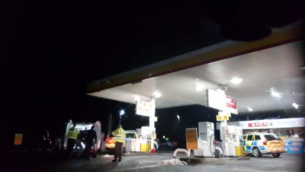 Police vehicles at the Shell Garage on Forfar Road