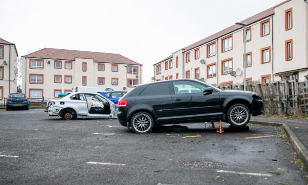 Two of the vehicles situated within the communal car park.