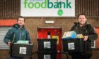 Chief Recycling Officers Ali Smith and Ryan Russell outside the foodbank ready to make a donation with the profits from the glass recycling.
