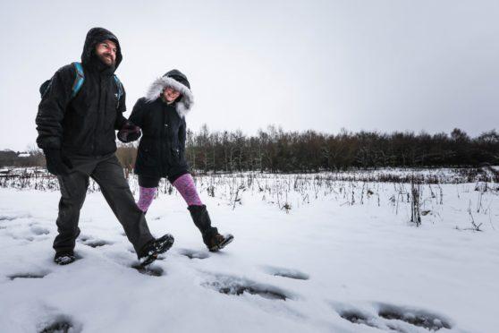 Karolina Jania and Brian Keith start their walk up the snowy Sidlaw Hills.