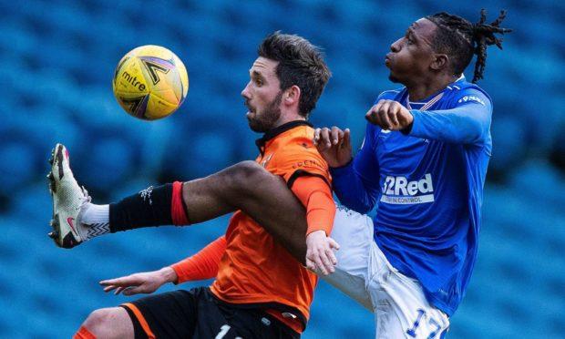 Dundee United hitman Nicky Clark and Rangers midfielder Joe Aribo battle for possession at Ibrox last weekend.