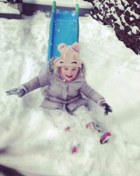 Rae enjoying the snow in her back garden.