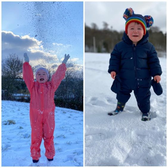 Ella and Noah Stewart from Fintry. One loving the snow, the other hating it.