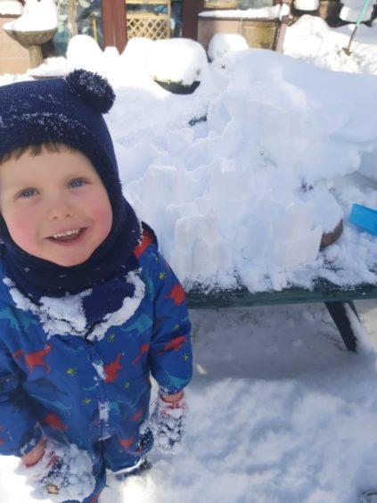 Dillon age 4, building snow castles in Lochee.