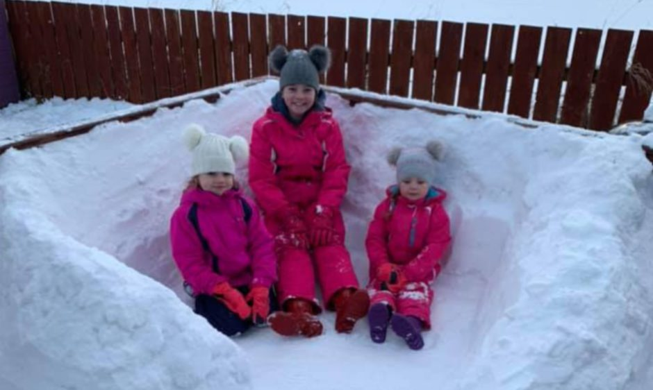 Ellis, 11, Jessica, 6, and Heidi, 5, with their snow seat in Brechin.