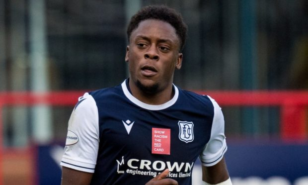 DUNDEE, SCOTLAND - OCTOBER 24: Dundee's Jonathan Afolabi receives treatment for an arm injury during a Scottish Championship match between Dundee and Greenock Morton at Dens Park, on October 24, 2020, in Dundee, Scotland. (Photo by Ross Parker / SNS Group)