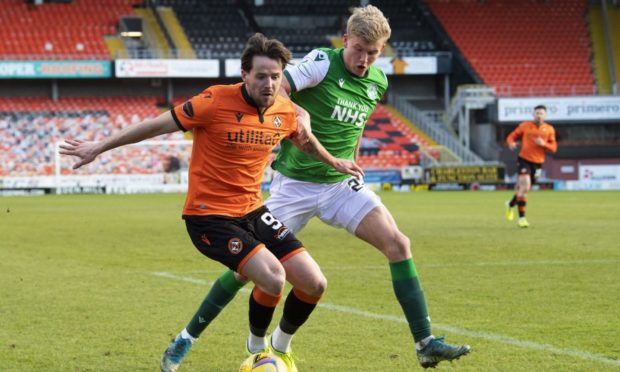 Marc McNulty and Hibs' Josh Doig battle for possession on Saturday.