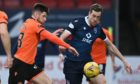 Dundee United midfielder Calum Butcher battles with Jordan White.