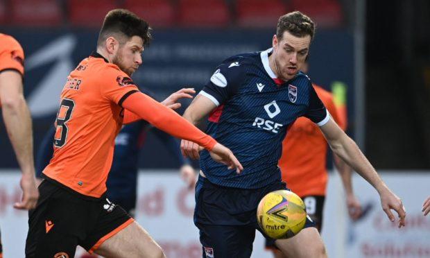 Dundee United midfielder Calum Butcher battles with Jordan White.