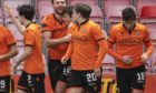 Dundee United players celebrate Ryan Edwards making it 2-0.