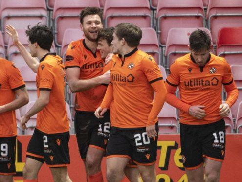 Dundee United players celebrate Ryan Edwards making it 2-0.