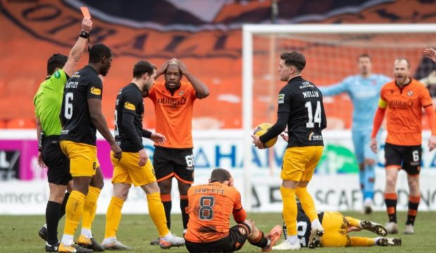Ref Nick Walsh shows Peter Pawlett the red card.