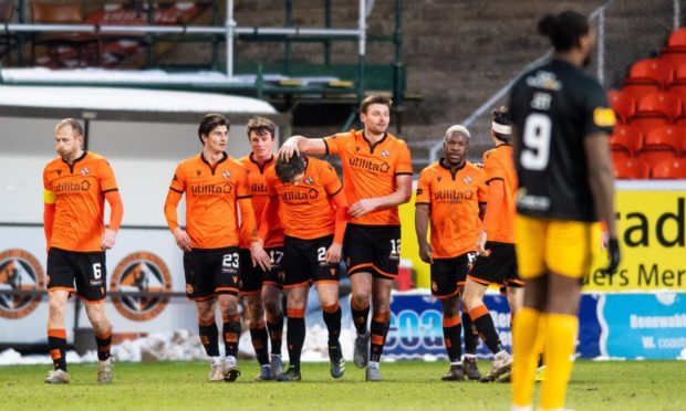 Lawrence Shankland (No 24) is congratulated by his Dundee United team-mates after notching his second goal in last Saturday's 3-0 win over Livingston.
