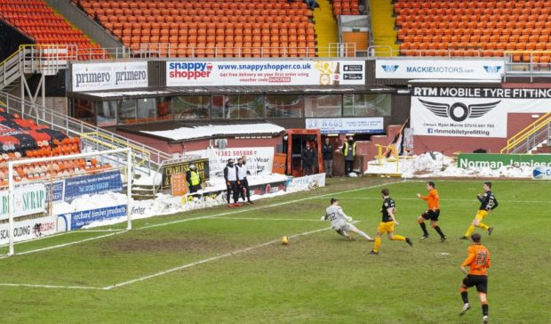 lawrence Shankland scores the first of his double.