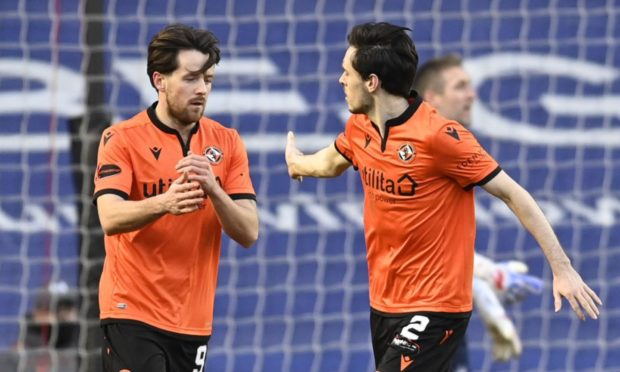 Marc McNulty (left) celebrates his goal against Rangers with Dundee United team-mate Liam Smith.