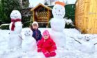 Abby, 5, and Ruby, 1, Thomson with their snow family in Kirriemuir.