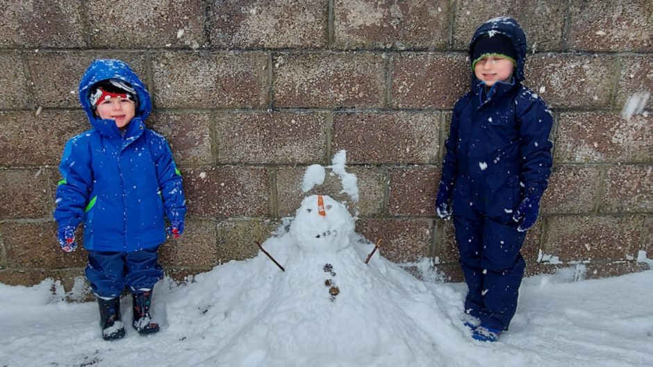 Alexander, 4, and Hamish, 2, with Olaf.