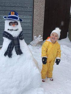Ayla, aged 2, with her snowman in Monifieth.
