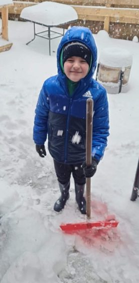 Cameron Maclachlan, aged 9 from Dundee helping to clear the garden.