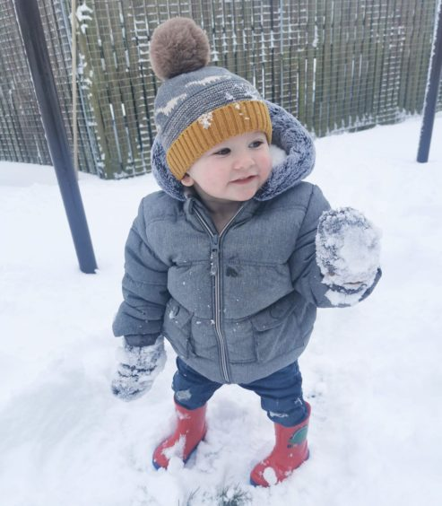 Cody aged 13 months, in the snow for the first time.