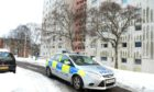 Police attend the incident at Dudhope Court.