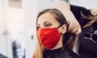 Woman wearing red face mask getting fresh styling at a hairdresser shop; Shutterstock ID 1745431553; Purchase Order: My Weekly - March 6; Job: Health; 33647817-cba9-4568-9617-95bb12863e14