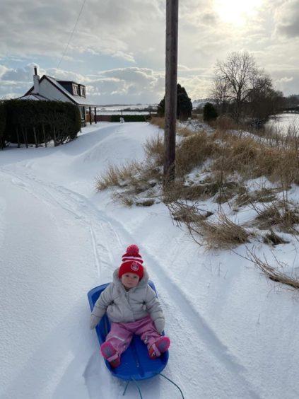 Jess enjoying her snow adventures by Montrose.