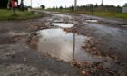 A potholed road in Letham, Angus.