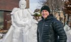 Douglas Roulston has created a snow sculpture in his front garden and is raising funds for the Archie Foundation.