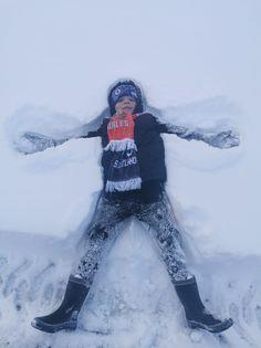 Lewis, 7, making snow angels in Menzieshill whilst on a trek to the shops.