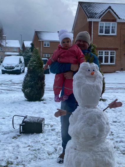 Luna Dryden, 17 months, with her grandad and Olaf in Arbroath.