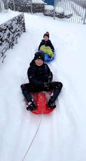 Mason aged 8 and Max age 2 heading to the local shops for essentials.