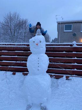 Mia Mckenzie aged 6 and her snowman called Ivy, named after her sister.