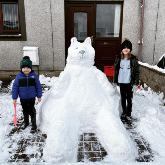 Millie, 9, and Ruben, 4, with their creation in Carnoustie.