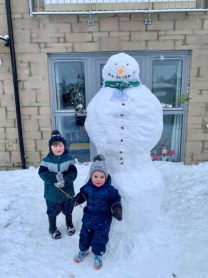 Ruben Conway and Cohen Smith enjoying the snow in Carnoustie.