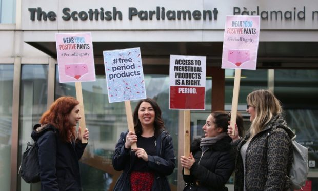 Monica Lennon MSP, second left, joined by supporters of the Period Products bill at a rally outside Parliament in Edinburgh in February 2020.